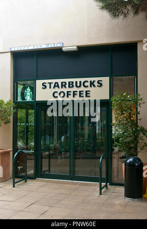 Front Entrance Door To A Starbucks Coffe Shop - Stock Image