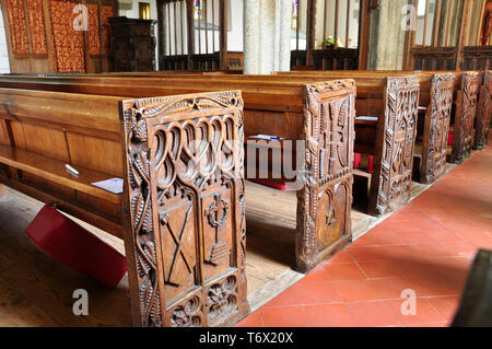 Elaborately Carved pew ends in St Winnow church , Cornwall,England,UK - Stock Image