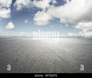 empty road with cloudy sky background - Stock Image