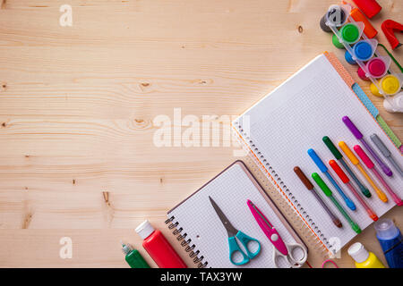 School supplies on a wooden desk with copy space. Back to school concept. - Stock Image