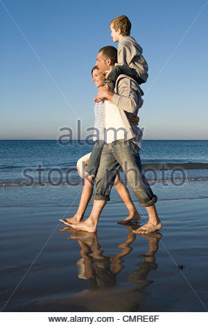 Family walking by the sea - Stock Image