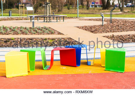 Row of colorful seats at the Rataje park in Poznan, Poland - Stock Image