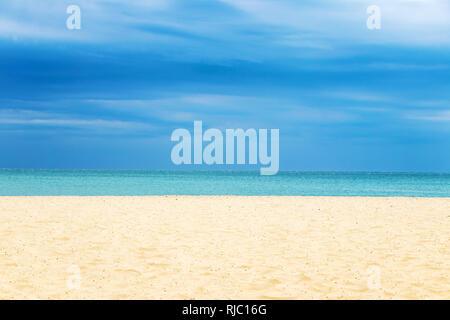 sandy beach blue sea and blue sky on the horizon - Stock Image