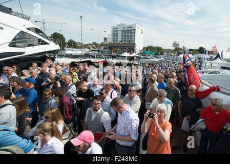 Southampton, UK. 11th September 2015. Southampton Boat Show 2015. Crowds of visitors flock to the Sunseeker stand - Stock Image