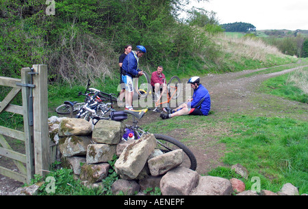 Repairing a flat tire during bike riding the High Peak Trail Peak District Derbyshire Great Britain - Stock Image