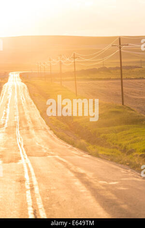 Open road at sunset, Montana, USA - Stock Image