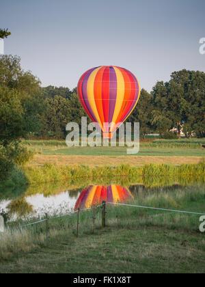 Balloon landing on meadows near river Aller, Altencelle, Celle, Germany - Stock Image