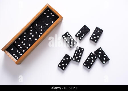 Dominoes on white surface - Stock Image