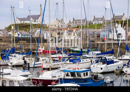 Boats moored in harbour of fishing village on Moray Firth coast. Findochty, Morayshire, Scotland, UK, Britain - Stock Image