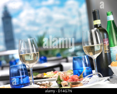 Wine glasses seafood dish on table restaurant - Stock Image