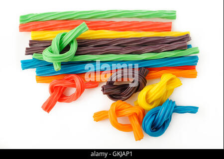 colorful licorice candy shaped like a twisted rope on white background - Stock Image