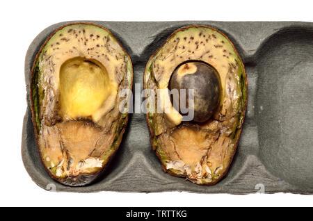 Rotten avocado cut in half - Stock Image
