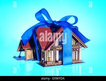 Model house as present with bow - Stock Image