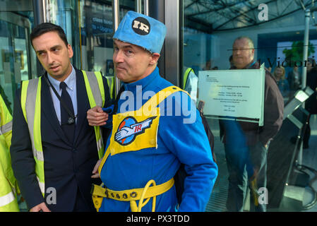 London, UK. October 19th, 2018. 'Commander Neil Godwin Tracy' of International Rescue  from Tracy Island carrying his ship Thunderbird 2 to the Dept for Business, Energy and Industrial Strategy (BEIS) is refused entrance. He had come to offer his organisation's assistance, to produce policies which which recognise the desperate need to cut carbon emissions to avoid disastrous global warming and climate change by banning all fracking. Security staff at the ministry, which campaigners allege has spent more time on changing its name than developing sensible policies, refused to allow him to enter - Stock Image