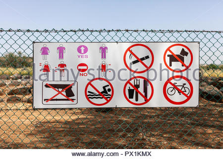 Entry Condition Sign, with many conditions. No guns, knives, dogs, bikes, eating, drinking, smoking, or swimming, and wear the right clothes. - Stock Image