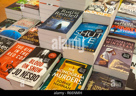 Murder mystery paperback books stacked for sale in a bookshop - Stock Image