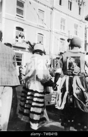 Carnival in Torquay, Devon -- people in costume.      Date: circa 1930 - Stock Image