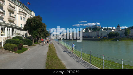 Salzach River and Hohensalzburg Castle above the city of Salzburg, Austria. The Old Town (Altstadt) is a UNESCO World Heritage Site. - Stock Image