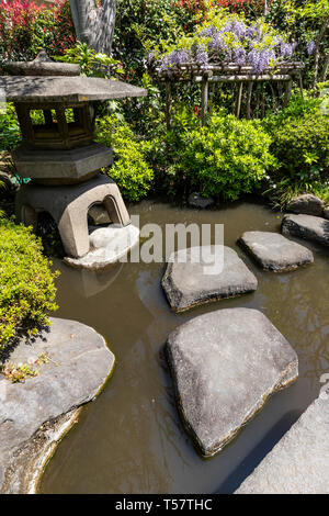 Yakushi Fountain Garden has been restored to its original Edo Period glory; it is located located just off the Nakasendo Road.  Shimizu Yakushi, who u - Stock Image