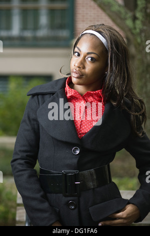Waist-up portrait of a young woman, Charleston, South Carolina, USA - Stock Image