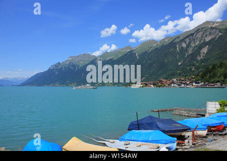 Boats on the shore of Lake Brienz. - Stock Image