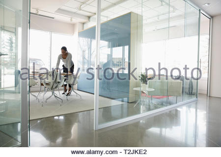 Businesswoman working in modern conference room - Stock Image