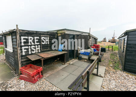Selling fresh Fish in the Hastings Net Shops, Fisherman black wooden huts at Hastings at Hastings, East Sussex, England , UK - Stock Image