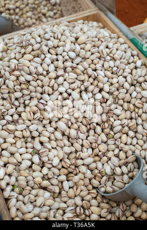 Pistachio nuts with scoop on display for sale on market stall at old street market - Mercado -  in Ortigia, Syracuse, Sicily - Stock Image