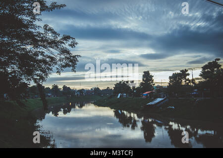 beautiful evening and sky reflection in the clear water on the river - Stock Image