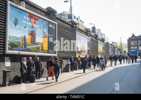 Smokers using the exterior smoking area outside Paddington Station, London - Stock Image