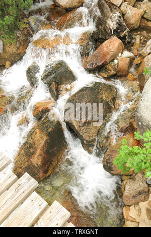 small creek inside the Aigüestortes National Park in the Catalan Pyrenees, Spain - Stock Image