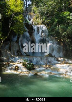Upper tier of three tiered Tat Kuang Si Waterfalls in Kuang Si Waterfalls Park  near Luang Prabang Laos Asia in unspoilt pristine jungle area - Stock Image