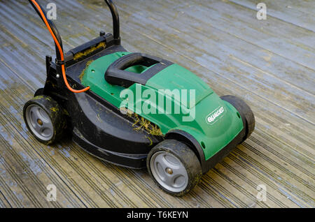 Qualcast Electric Rotary Lawn Mower, Qualcast was founded by Charles H Pugh Ltd in 1921. - Stock Image