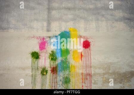 Wall with small painted color round spots and empty place in the center - Stock Image