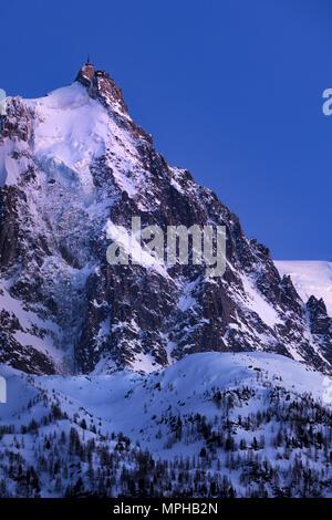 Aiguille du Midi needle at twilight. Mont Blanc mountain range, Chamonix, Haute-Savoie, Alps, France - Stock Image