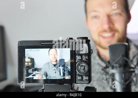 Camera display showing young male filming himself podcast content creator - Stock Image