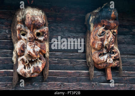 Grotesque wooden masks carved for the Shrovetide Tschaggatta festival in the Loetschental, Valais, Switzerland - Stock Image
