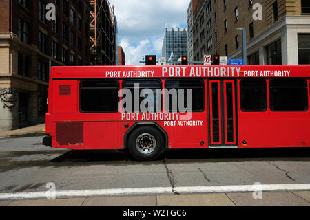 A red Pittsburgh Port authority bus travels along Wood Street in Pittsburgh, Pennsylvania, USA - Stock Image