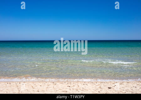 Detail of beach with turquoise and blue sea. - Stock Image