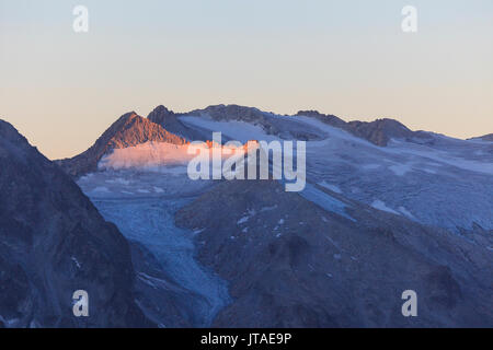 View of the Pisgana glacier and rocky peaks at dawn, Valcamonica, border Lombardy and Trentino-Alto Adige, Italy, Europe - Stock Image