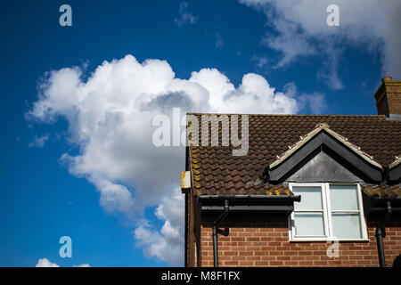 white fluffy clouds - Stock Image