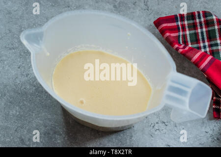 Raw Pancake Dough in Plastic Carafe Ready to Pour on Pan. Ready to Cook - Stock Image