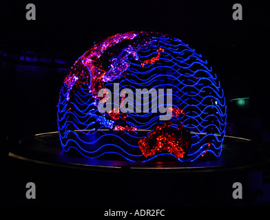 Swarovski crystal worlds art object Interlaced globe world cross linking - Stock Image