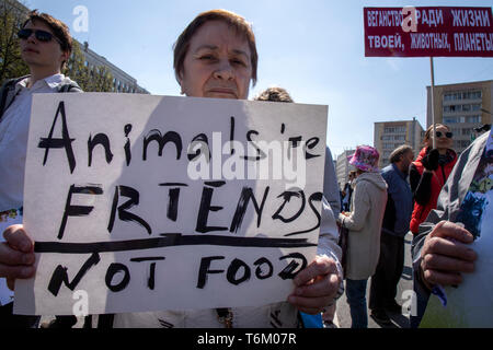 Moscow, Russia. 1st May, 2019 People hold posters during an animal march through the streets of Moscow, Russia - Stock Image
