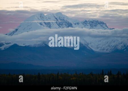 Sunrise happens behind Mt. Drum in remote Alaska - Stock Image