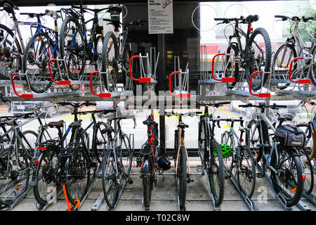Double storey bike rack in urban setting. Efficient storage and environmentally friendly. Wellington New Zealand 4th March 2019 - Stock Image