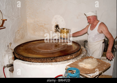 Making Kataifi, a very fine thread like pastry used in traditional sweets and desserts, Rethymno Crete Greece - Stock Image
