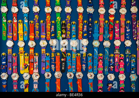 image of cartoon character wrist watches on display - Stock Image