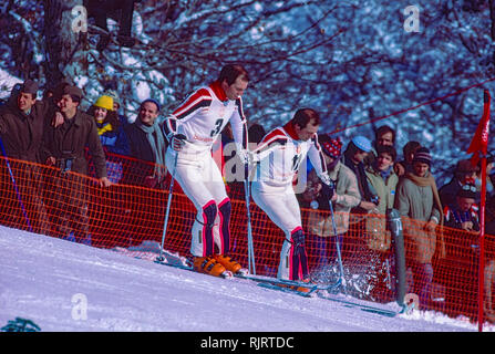 Phil Mahre (USA) Gold -R-, Steve Mahre (USA) Silver,, winners of the Men's Slalom at the 1984 Olympic Winter Games diring curse review. - Stock Image
