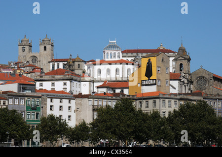 Rooftops with an advertisement for Sandeman Port, Oporto, Portugal - Stock Image